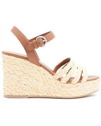 fa3979946ea Prada - Straw Wedge Heel Sandals - Lyst