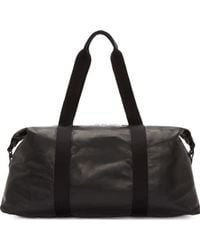 Alexander McQueen Black Leather Duffle Bag - Lyst