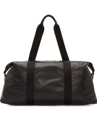 Alexander McQueen Black Leather Duffle Bag - Lyst