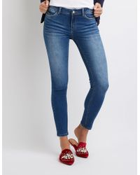 Charlotte Russe - Stretchy Mid Rise Skinny Jeans - Lyst