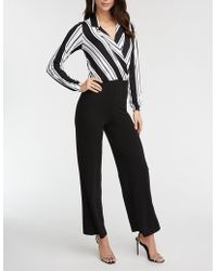 104522f6ba0 Lyst - Charlotte Russe Plus Size Striped Button Up Jumpsuit