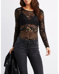9b23768103509 Lyst - Charlotte Russe Plus Size Studded Caged Bodysuit in Black