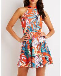 0603568278e5 Lyst - Charlotte Russe Floral Caged Back Skater Dress in Red