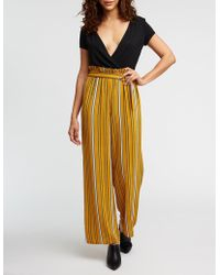 a2c0a0ba7f7 Lyst - Charlotte Russe Floral Culotte Jumpsuit in Yellow