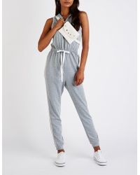 1da12aed8d8 Charlotte Russe - Varsity Striped Hooded Jumpsuit - Lyst