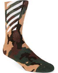 38da17809a3d Off-White C O Virgil Abloh Logo Print Cotton Blend Socks in White ...