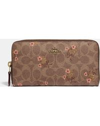 COACH - Accordion Zip Wallet In Signature Canvas With Floral Bow Print - Lyst