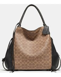 a3f0c41ef7 COACH - Edie Shoulder Bag 42 In Signature Canvas With Whipstitch - Lyst