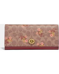 COACH - Envelope Wallet In Signature Canvas With Floral Bow Print - Lyst