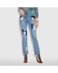 COACH - Embellished Denim Pants - Lyst