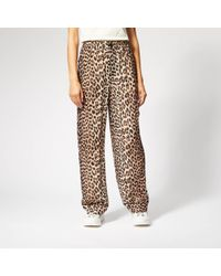 418a9207cb2 Ganni Calla Relaxed-fit Mid-rise Stretch-silk Trousers in Black - Lyst