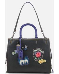 COACH - Women's Disney X Coach Dark Fairytale Patches Rogue Bag - Lyst