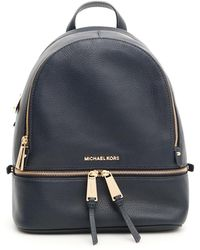 f18deb6aadb7 Lyst - MICHAEL Michael Kors Rhea Logo Mini Twill Backpack in Natural