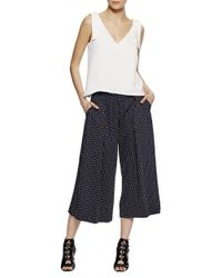 Nicole Miller | Ditzy Dot Pleat Culottes | Lyst