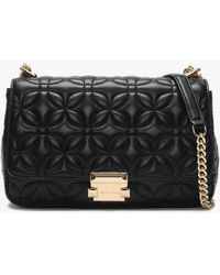 b0e64cc5f448 Michael Kors  sloan  Small Quilted Denim Shoulder Bag in Black - Lyst