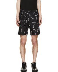 Surface To Air Black Floating Skeleton Shorts black - Lyst