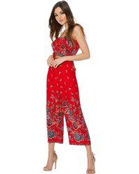 Quiz - Red Crepe Floral Print Culotte Jumpsuit - Lyst
