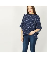Izabel London - Navy Polka Dot Flared Sleeve Top - Lyst