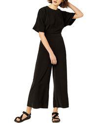 9a3a40ea3ff1 Warehouse Rhinestone Crepe Jumpsuit in Black - Lyst