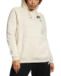 7d47a6da98c7 Lyst - Nike Sportswear Rally Funnel Neck Women s Sweatshirt in Green