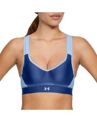 d7d8ad4266999 Lyst - Under Armour Women s Armour® Mid Warp Knit Sports Bra in Blue