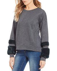 Jessica Simpson - Molly Faux Fur Stripe Cuff Sweatshirt - Lyst
