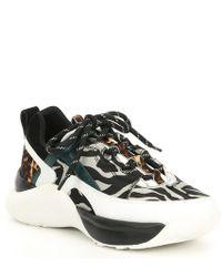 c73abdad9 Michael Kors Amanda Animal-Print Low-Top Sneakers in Black - Lyst