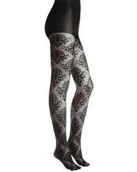 b740c95613781 Lyst - Wolford Leah Stripe Sheer Tights in Black