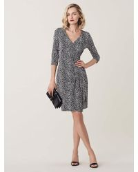 d8408e0636fe Lyst - Diane von Furstenberg Julian Printed Silk Wrap Dress in Black