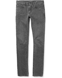 Saint Laurent Slim-Fit Washed-Denim Jeans - Lyst