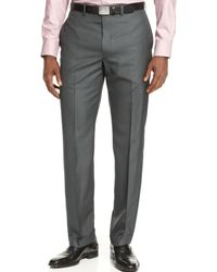 Calvin Klein Flat-front Grey Solid Slim-fit Dress Pants - Lyst
