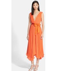 Alice + Olivia Women'S Alice + Olivia 'Kip' Pleated Stretch Silk Midi Dress With Satin Sash - Lyst