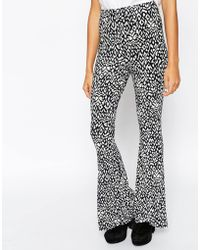 Asos Reclaimed Vintage Co-Ord Jersey Flared Pants In Abstract Print - Lyst