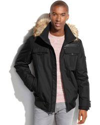 Sean John Hooded Faux-Fur-Trim Bomber Jacket - Lyst