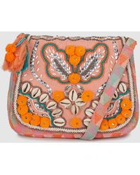 Green Coast - Wo Fabric Crossbody Bag In Pink Tones With Beading And Pompoms - Lyst
