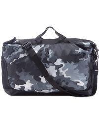 3bf16b715d1 The North Face - Psychedelic Camo Flyweight Duffel - Lyst