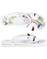 c95871bf839f8f Ted Baker - Susziep Hummingbird Bow Flip Flops In White - Lyst