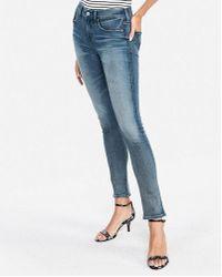 Express - Mid Rise Medium Wash Denim Perfect Skinny Jeans, Women's Size:00 Short - Lyst