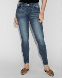 Express - Mid Rise Medium Wash Stretch Jeggings, Women's Size:2 - Lyst