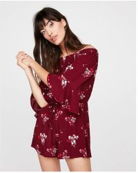 e982fb2e2cc6 Express - Floral Off The Shoulder Bell Sleeve Romper - Lyst