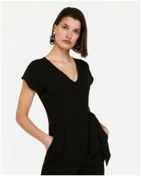 154aaa6ca23 Lyst - Express Crossover Cami Jumpsuit in Black