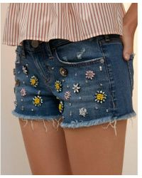 Express - Low Rise Relaxed Gemstone Raw Denim Shorts - Lyst