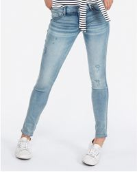 Express Low Rise Ripped Light Wash Jeggings,
