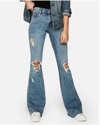 Express - Mid Rise Ripped Stretch Bell Flare Jeans, Women's Size:0 Short - Lyst