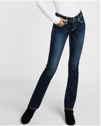 Express - Low Rise Thick Stitch Stretch Barely Boot Jeans, Women's Size:00 Short - Lyst