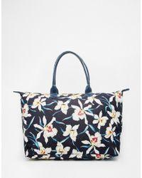 Mi-Pac - Weekender Bag In Orchid Floral Print - Lyst