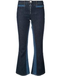 Courreges - Flared Crop Jeans - Lyst
