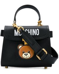 611682d2cc4e Moschino Teddy Bear Tab Faux Leather Tote Bag in White - Lyst