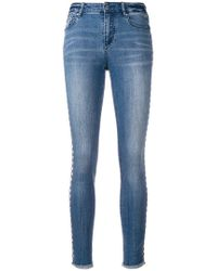 Armani Exchange - Jeans con borchie - Lyst