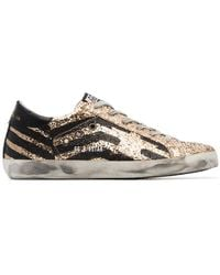 Golden Goose Deluxe Brand - Black And Metallic Gold Superstar Leather Trainers - Lyst